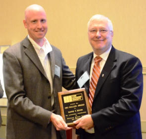 David Biggs accepts the Haller Award from Ben Harris, Chairman of the DPC.