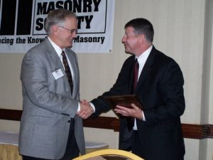 Dr. Russell H. Brown (left) is congratulated by TMS Executive Director Phillip Samblanet during the presentation of Brown's Honorary Membership plaque at The Masonry Society's 2006 Annual Meeting in Atlanta, Georgia.