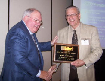TMS President Ray Miller (left) congratulates John Chrysler (right), recipient of the 2008 President's Award.