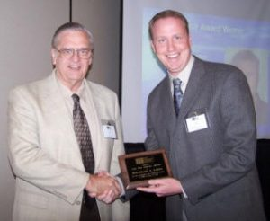 Ben Harris (right) accepts a 2008 Service Award from John Chrysler for his exceptional contributions to TMS behind the scene.