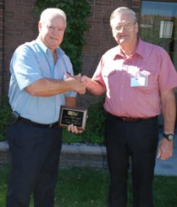 Paul Hoggatt (left) accepts congratulations from John Chrysler upon receiving a 2008 TMS Service Award for his exceptional service.