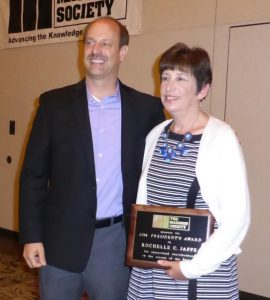Scott Walkowicz presents the 2014 TMS President's Award to Rochelle C. Jaffe.