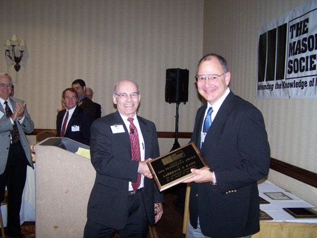 Larry Kahn (right) is congratulated by Dr. Max L. Porter(left) after being presented with the 2006 President's Award.