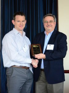 Russ Peterson (left) is presented with the TMS Service Award by Darrell McMillian (right).