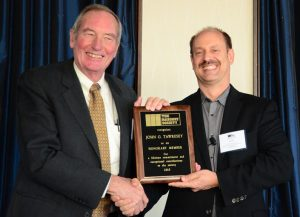 John Tawresey (left) is congratulated by TMS President Scott Walkowicz during the presentation of Tawresey's Honorary Membership at The Masonry Society's 2015 Annual Meeting in Indianaplois, Indiana.