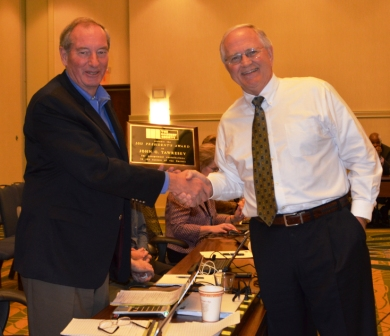 John G. Tawresey was awarded the 2013 President's Award from Russell Brown.