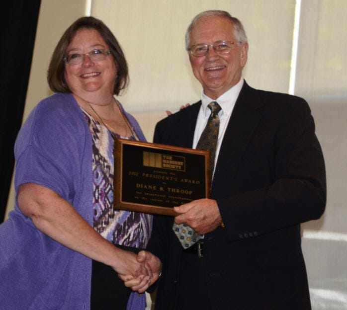Diane Throop was awarded the 2012 President's Award from Russell Brown.