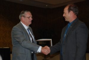 Scott Walkowicz (right) is congratulated by John Chrysler (left) after being presented with the 2010 President's Award.