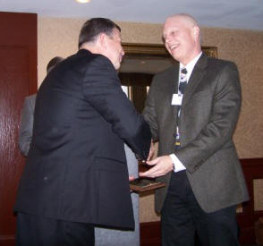 Bill Wood (right) accepts congratulations from Phillip Samblanet (left) upon receiving a 2007 TMS Service Award.