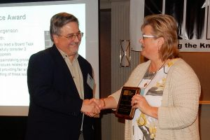 Jergenson (right) receives 2016 TMS Service Award from McMillian