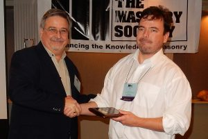 Thompson (right) receives 2016 TMS Service Award from McMillian