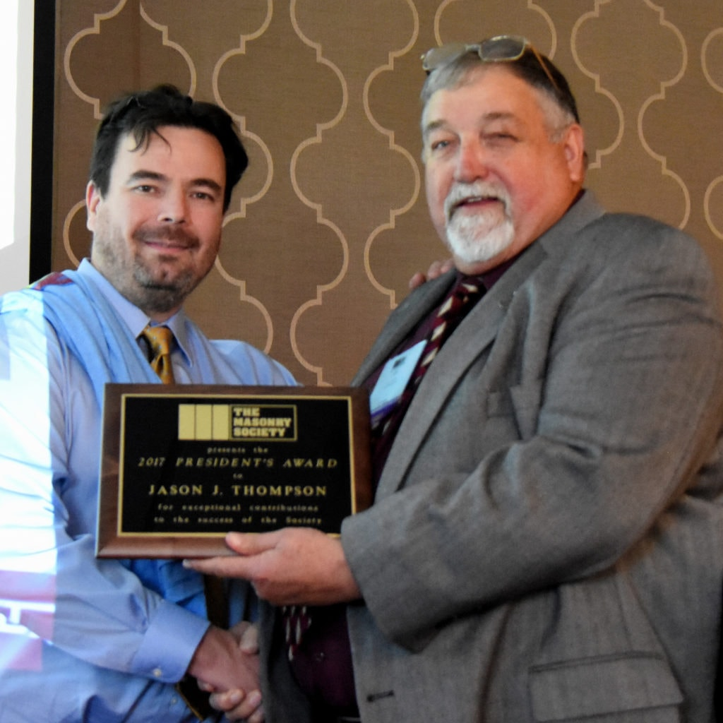 Jason J. Thompson (left) receives 2017 President's Award from Jerry Painter
