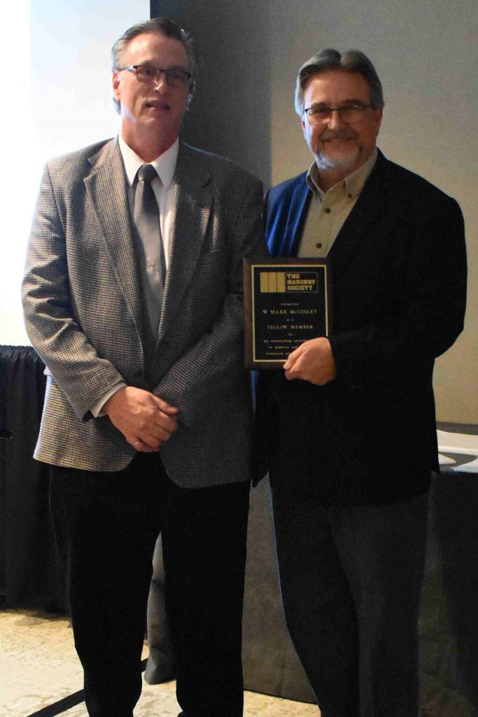 Dr. W. Mark McGinley (left) receives his Fellow Membership by TMS President Darrell McMillian