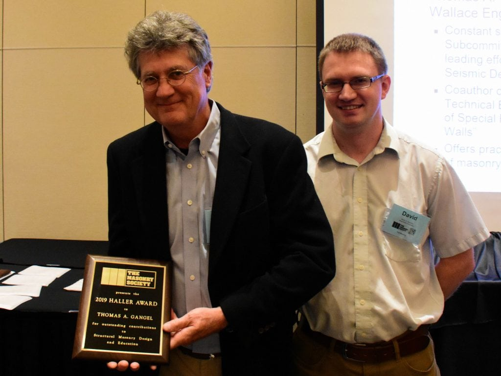 Tom Gangel (left) receives the 2019 Haller Award from David Sommer, Chair of the TMS's Design Practices Committee